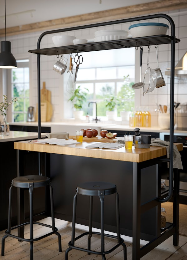 IKEA VADHOLMA black kitchen island with a solid wood worktop.