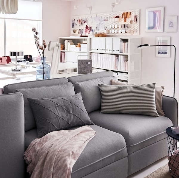 IKEA VALLENTUNA light grey 3-seater sofa in front of a home office workspace.