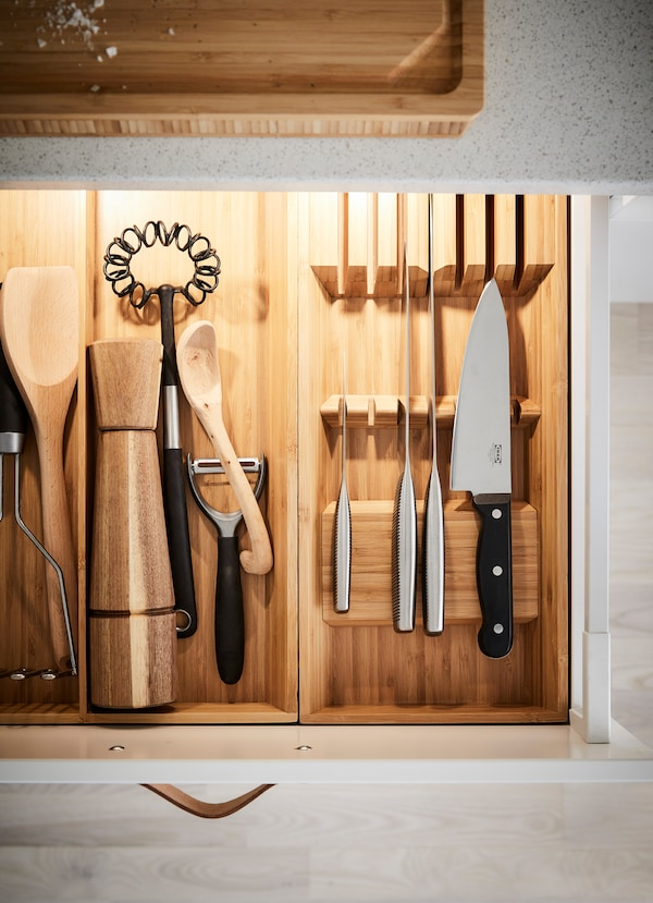 IKEA VARDGAGEN chef knives inside a kitchen drawer front with installed lighting.