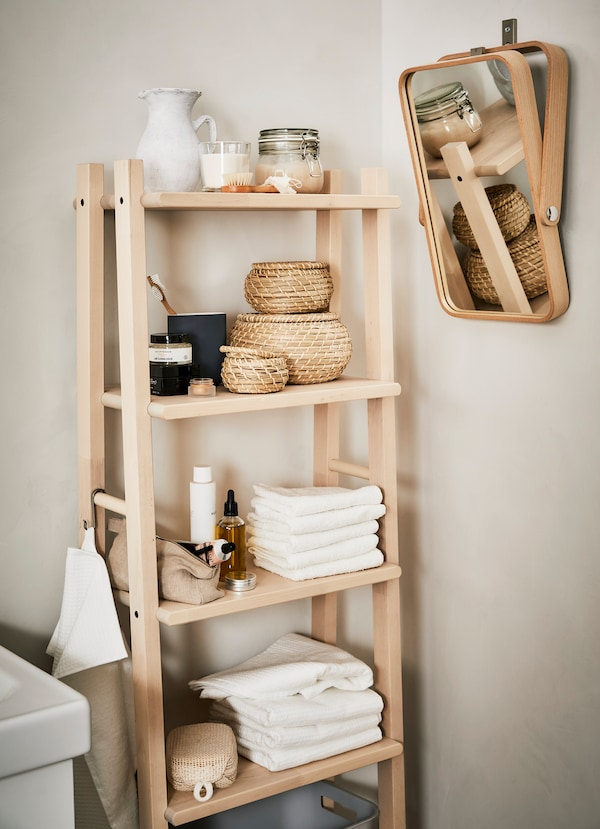 IKEA VILTO towel stand crafted from fine-grained birch, holding bath towels and small woven baskets.