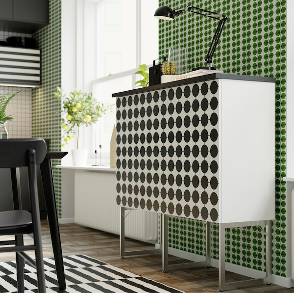 IKEA YTTERBYN black and white dotted kitchen cabinet door fronts being used on a BESTÅ white storage unit in the dining area.