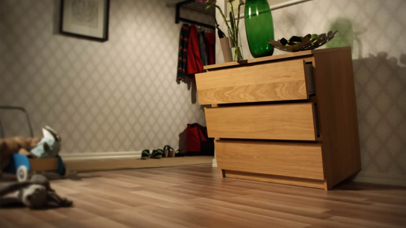 Image of a falling chest of drawer.