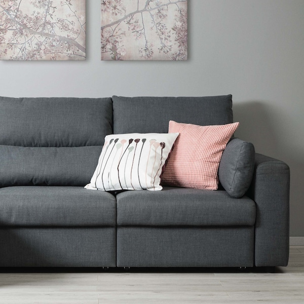 Image of a grey two seat ESKILSTUNA sofa and two cushions on the top