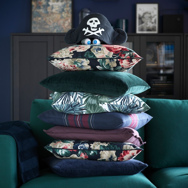 Image of many cushions stacked on top of each other.