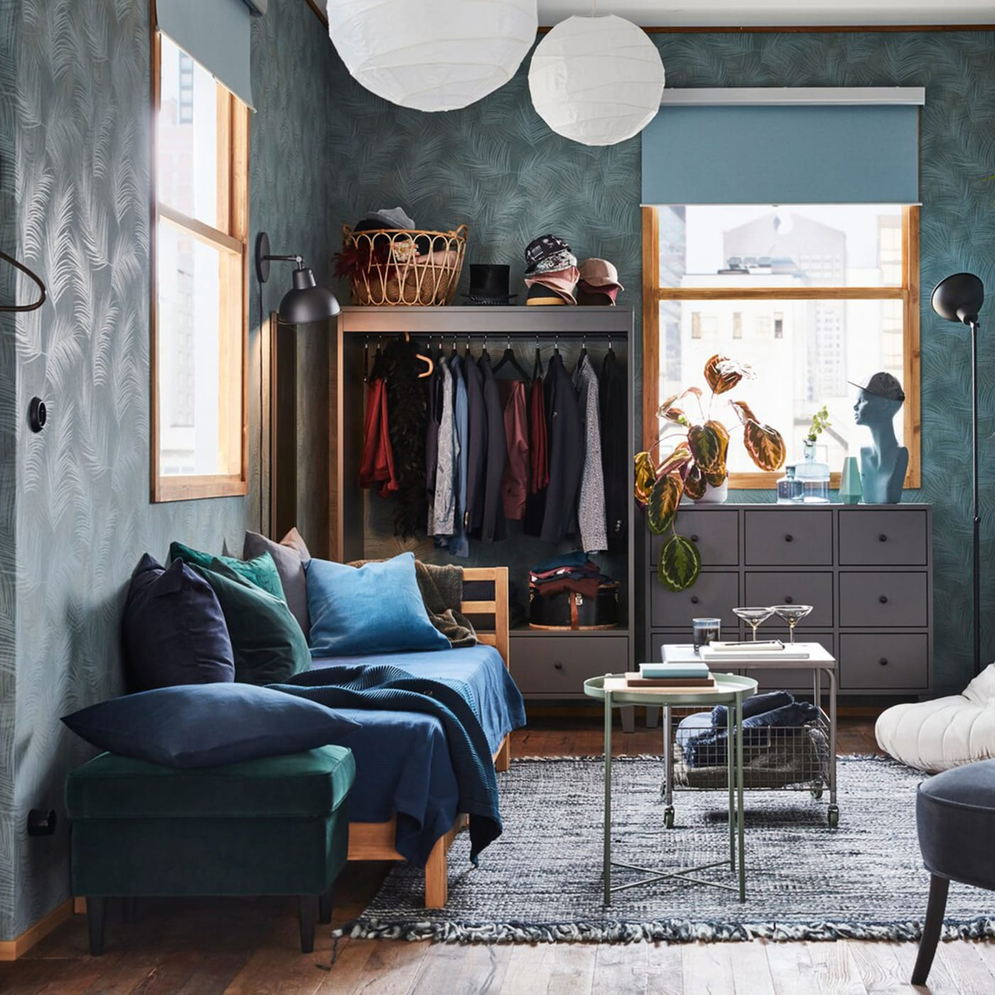In this small modern studio apartment, the storage cabinet, wardrobe and drawer unit are placed against different walls to make the living space more airy.