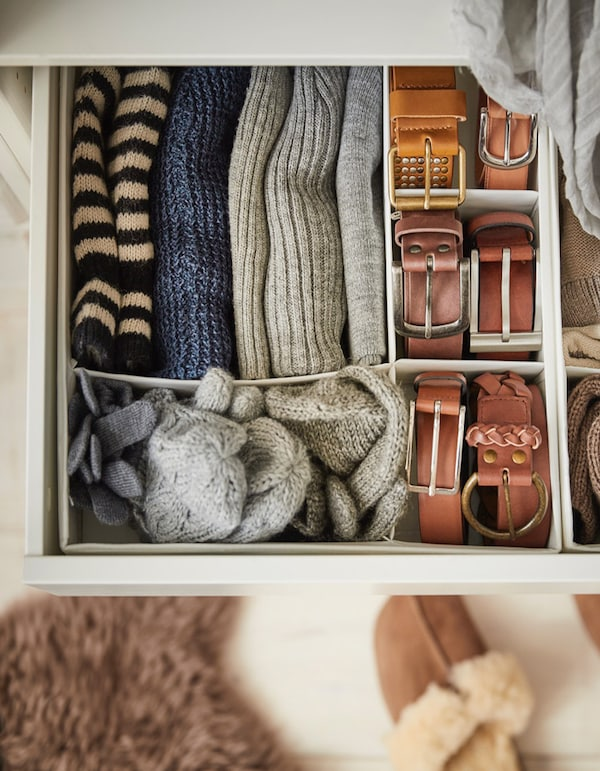 Inside of a drawer with an organiser to divide space.