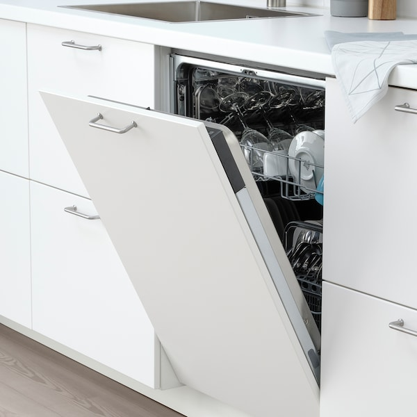 Integrated IKEA dishwasher in white modern kitchen that is open, showing clean plates and cups.