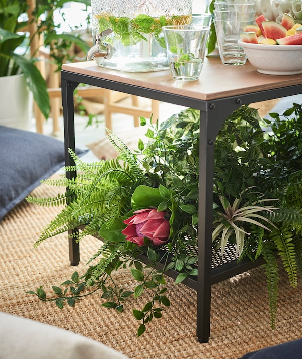 Invite the feeling of nature indoors without having to remember to water plants! Try some artificial plants such as IKEA FEJKA artificial potted plant in green plastic!