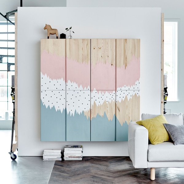 IVAR cabinets with a painted mural on them in blue, white and pink.