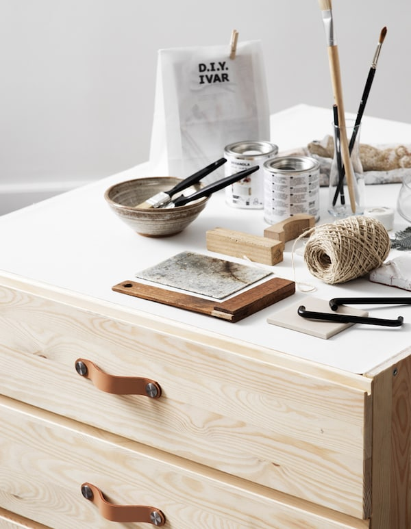IVAR chest of 3 drawers is so easy to personalise. Here we mounted two together from the back and glued a canvas cloth on top as a creative surface. The module is placed on wheels, making it easy to move around the room.