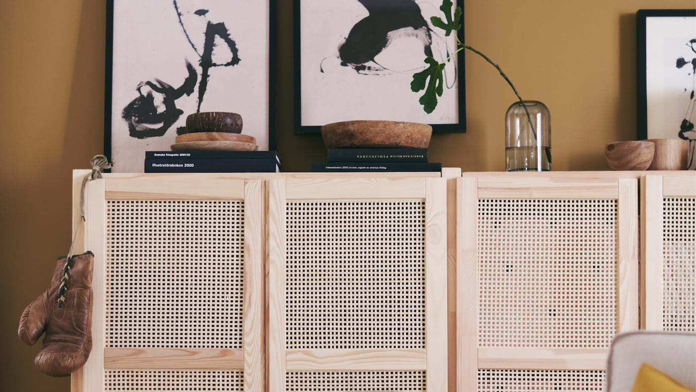 IVAR shelving units with bamboo doors create both storage and display space in a warm, casual living area.