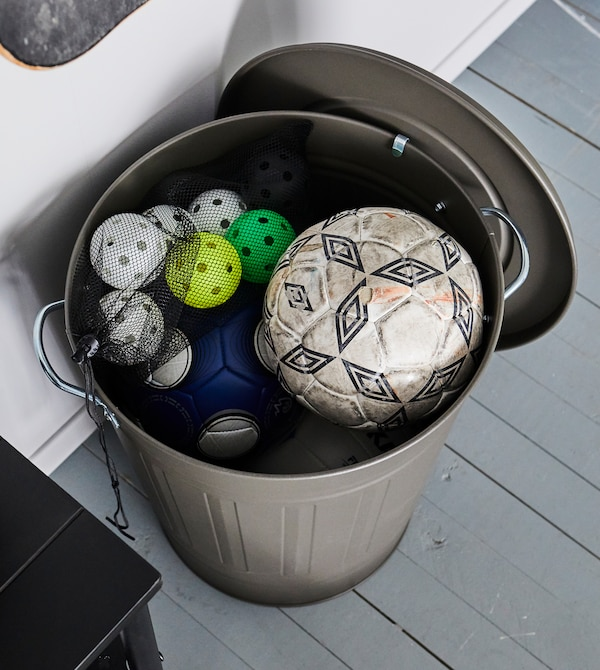 Keeps balls from rolling all over the place by keeping them all stashed in a large bin.