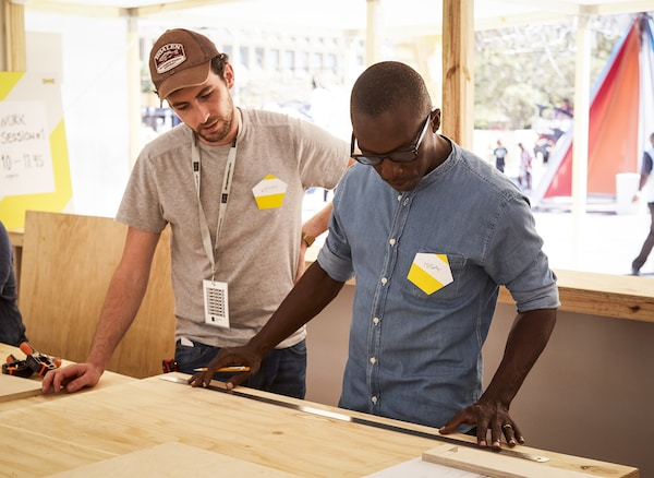 Kevin Gouriou and Issa Diabaté collaborating on designs at Design Indaba.