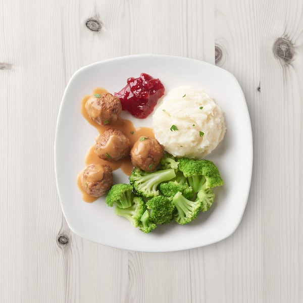 Kids meal with mashed potatoes, meatballs and broccoli.