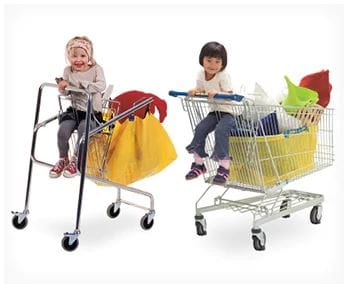Kids sitting in shopping carts.