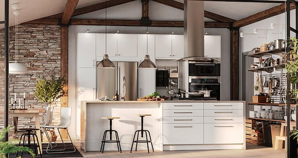 Kitchen with white RINGHULT cabinet fronts, two stools and loft ceilings