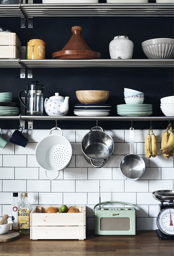 Kitchenware displayed on shelves.