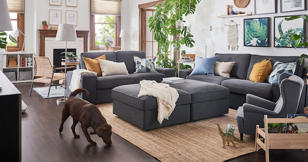 KIVIK grey sofa, loveseat and ottoman in a large room setting