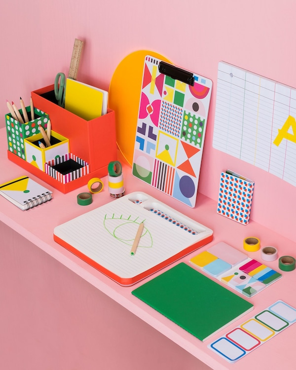 KNALLGUL desk organiser from IKEA with five loose, paper boxes shown with other KNALLGUL stationery.