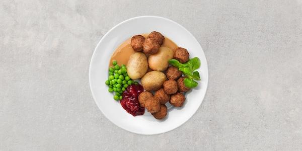 Köttbullar 12 st. Serveras med gräddsås, lingon, gröna ärtor och nykokt potatis.