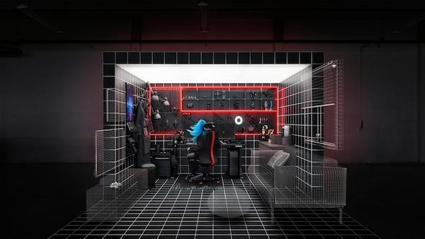 Kompletny zestaw gamingowy w czarno-białym pudełku, w którym produkty fizyczne spotykają się z wirtualną rzeczywistością, zilustrowaną siatką.