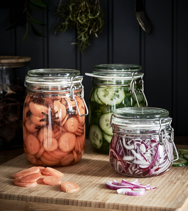 KORKEN jars with food on top of a bamboo chopping board