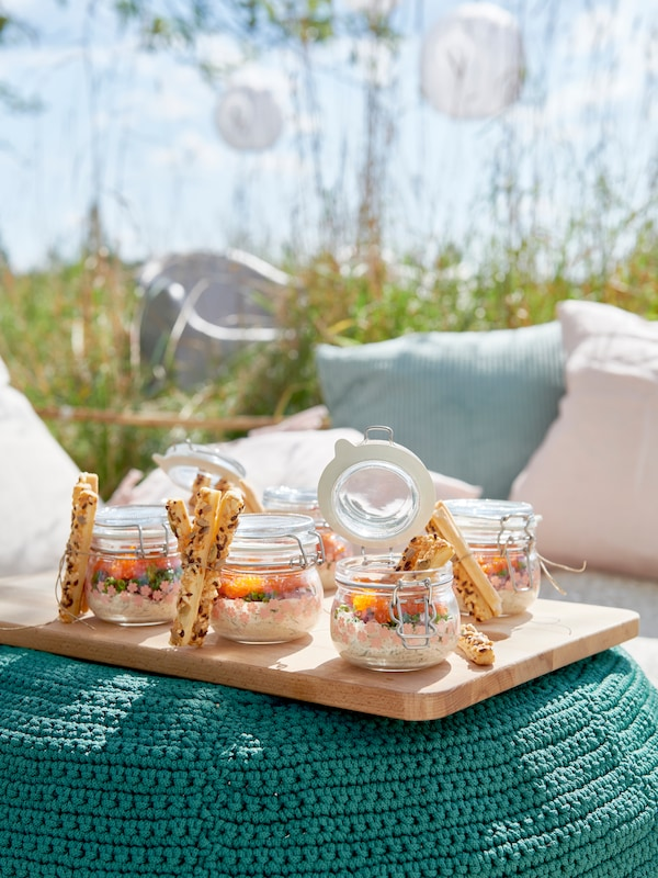 KORKEN jars with lids filled with a tasty meal.