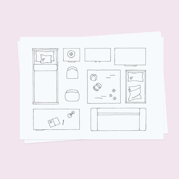 Kreslený návrh dětského pokoje na papíru.