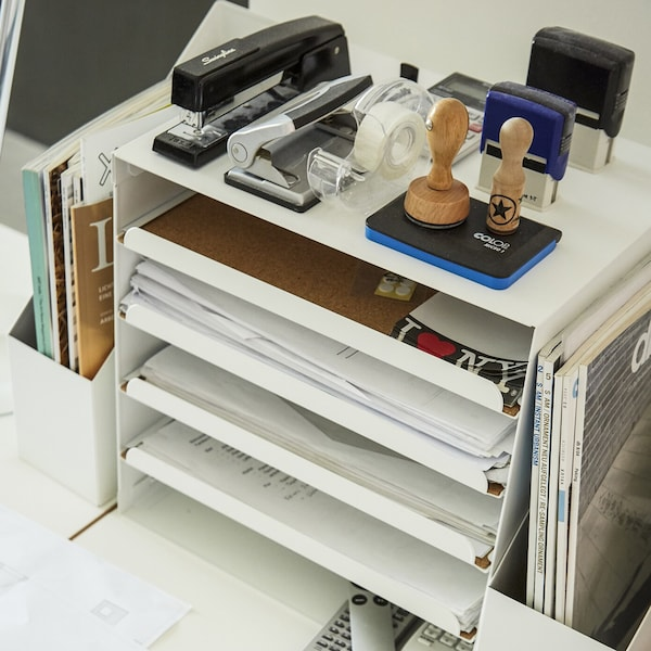 KVISSLE tray and stationery is placed on a desk.