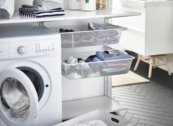 Laundry room with dryer and organized drawers that links to the ALGOT series page