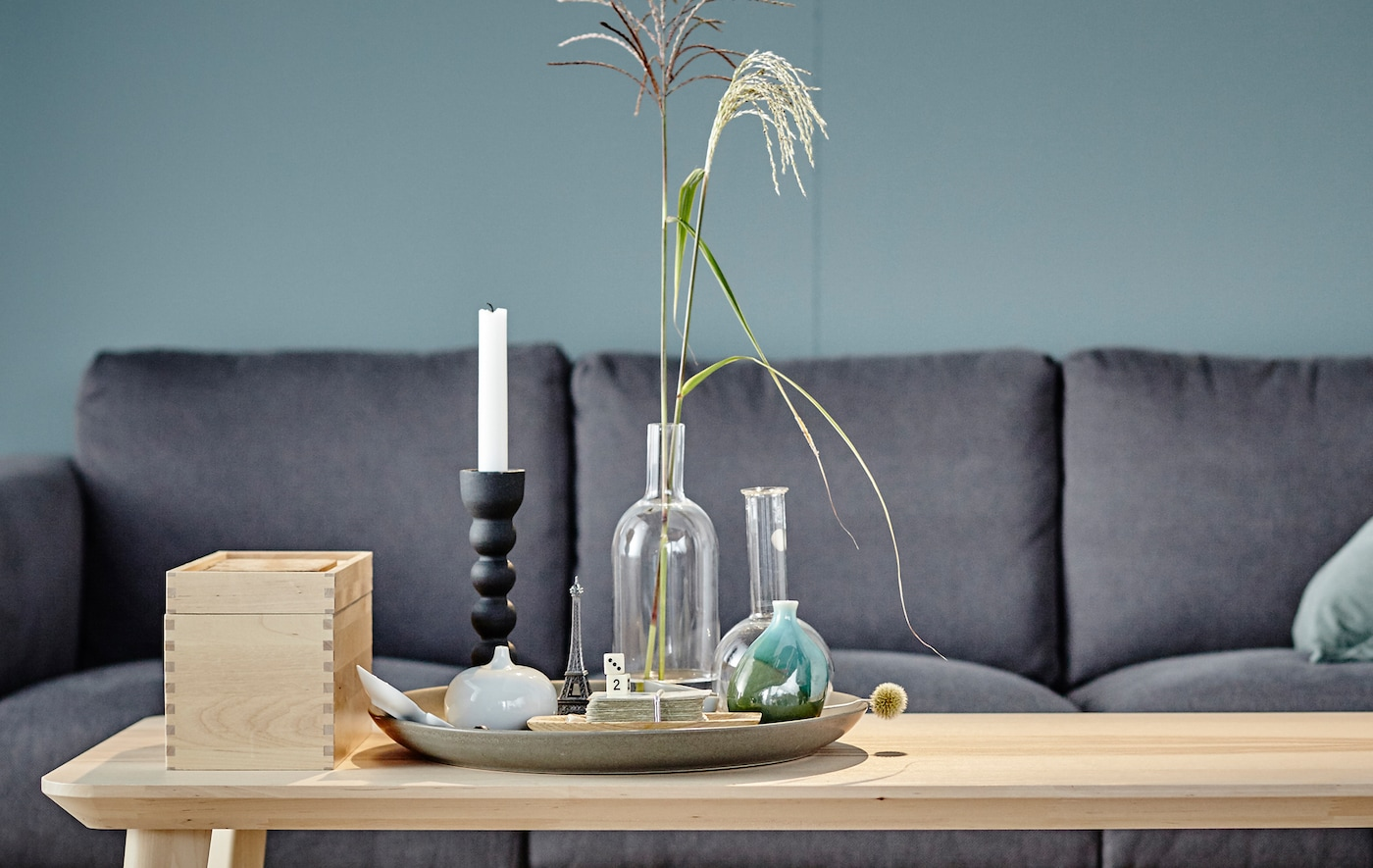 Learn how to create a perfectly organized coffee table just like our stylist.