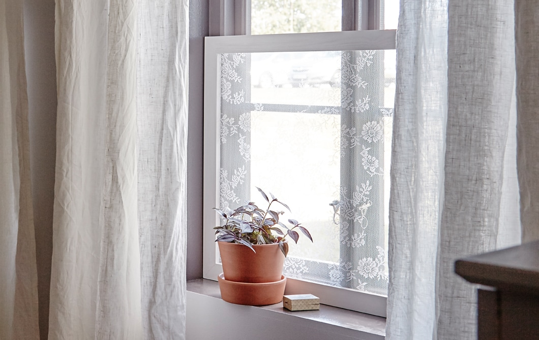 Let in light and keep out nosy neighbors with a quick curtain frame.