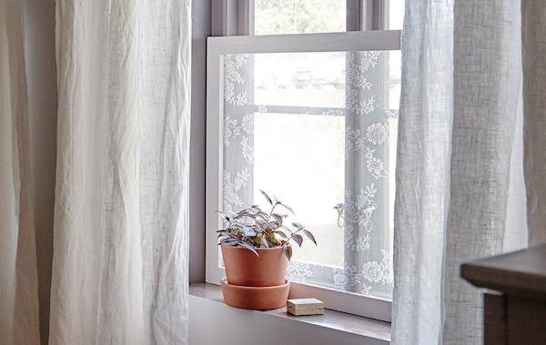 Let in light and keep out nosy neighbours with a quick curtain frame.