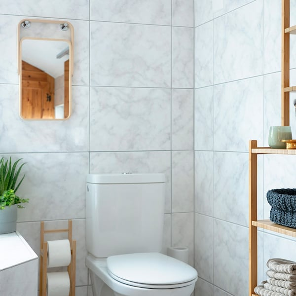 Light colours combined with IKEA wooden furniture makes the bathroom feel cosy.