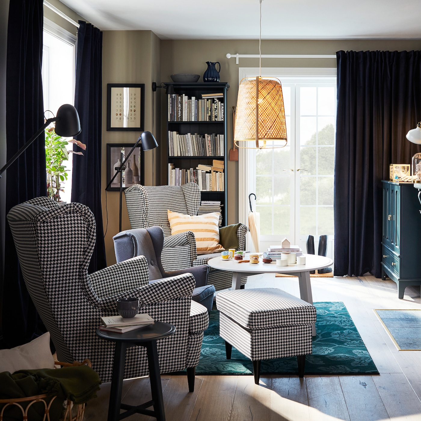 Link to 'A modern take on beloved classics' room - image of a living room with two houndstooth-patterned STRANDMON wing chairs