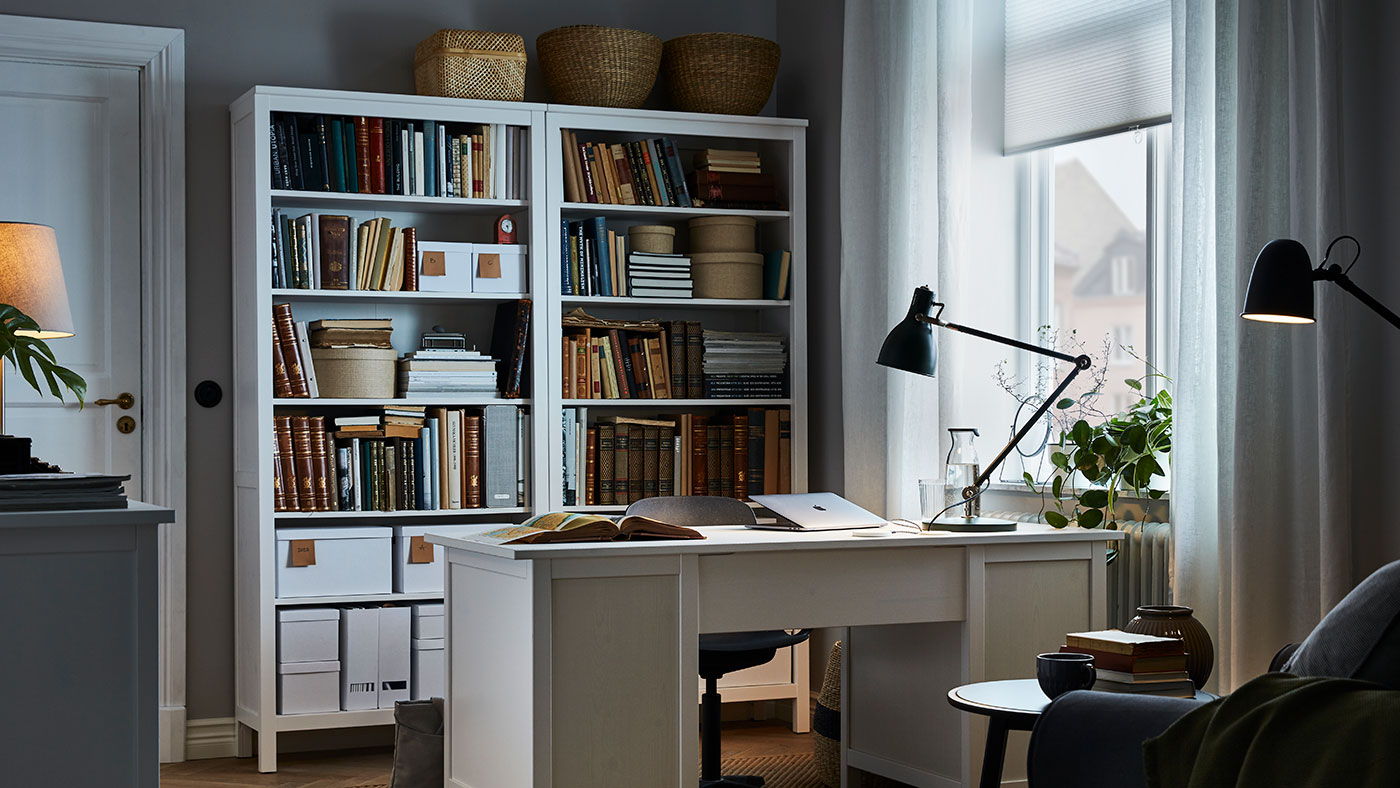 Link to 'Ask an IKEA Designer' - image of an elegant home office with a large white desk.