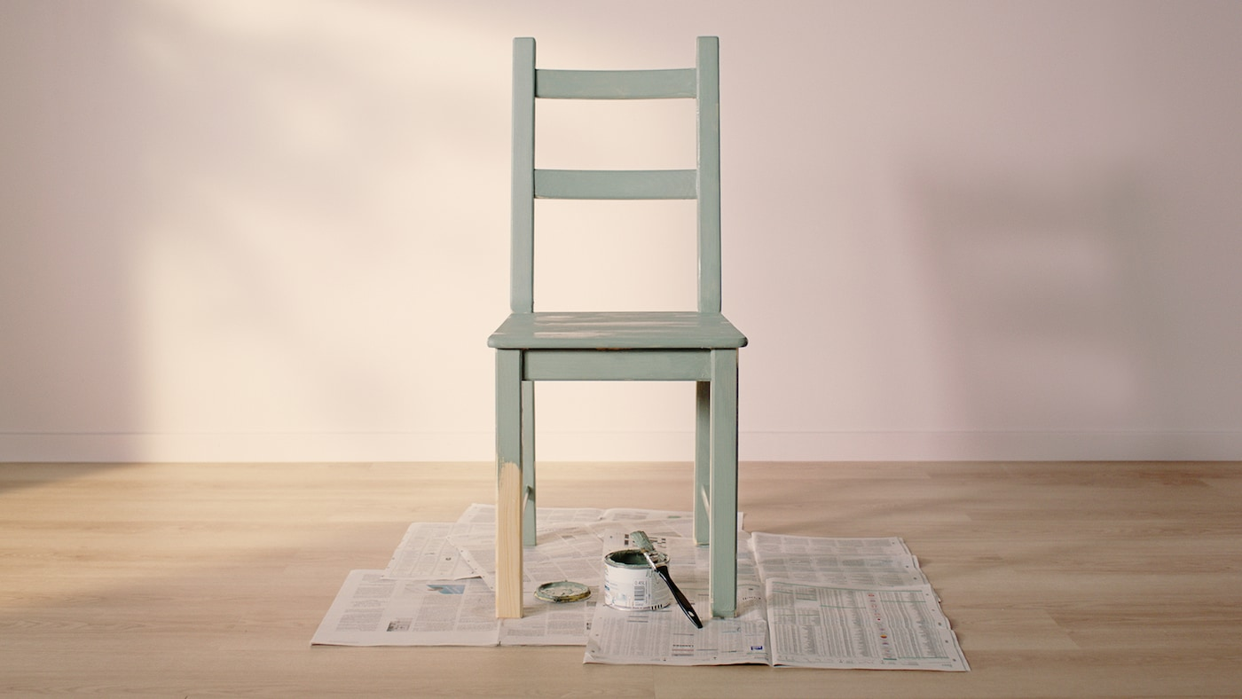 Link to 'How to choose furniture that lives longer' - image of an IVAR pine chair painted green next to a tin of paint and a paintbrush.