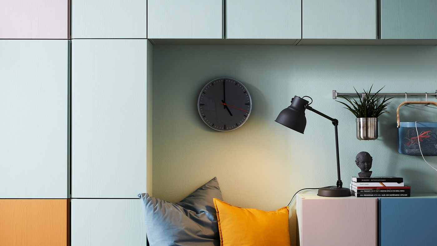 Link to 'Organize your living room storage in a playful way' - image of colour-coded IVAR storage units on a wall.