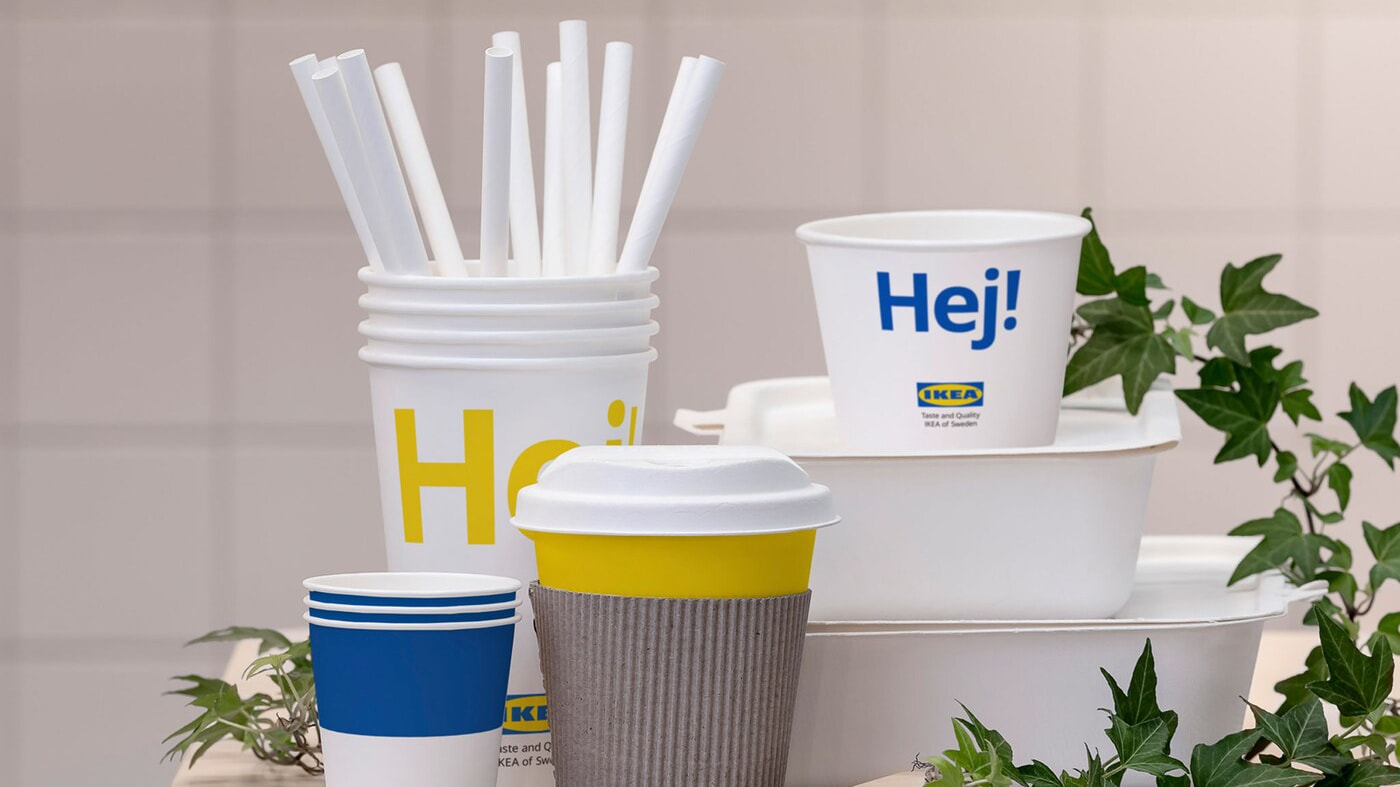 Link to 'Phasing out single-use plastic' - image of IKEA food containers, cups, straws and cutlery made from 100% renewable materials.