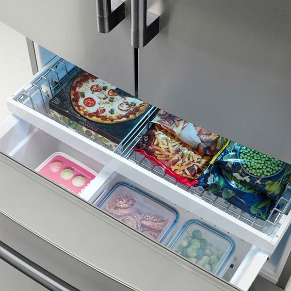 L'intérieur du tiroir de congélation du bas d'un réfrigérateur STJÄRNSTATUS.