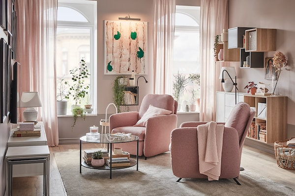 Living room decorated in pink and beige hues.