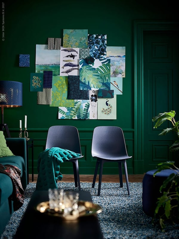 Living room in dark green and dark blue colours with two dining chairs