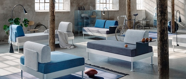 living room setting featuring different combinations of DELAKTIG seating in blue and grey