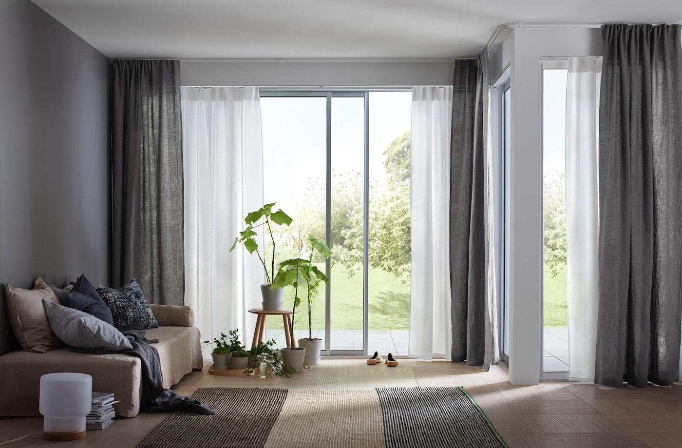 Living room with doors open to the garden.