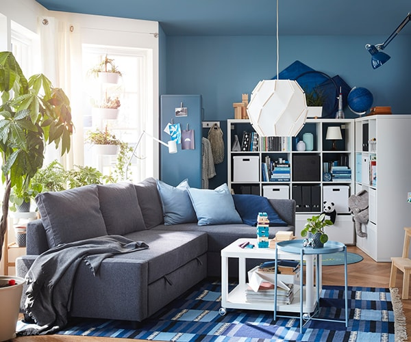 Living room with KIVIK lounges, walk through space and imagery on walls