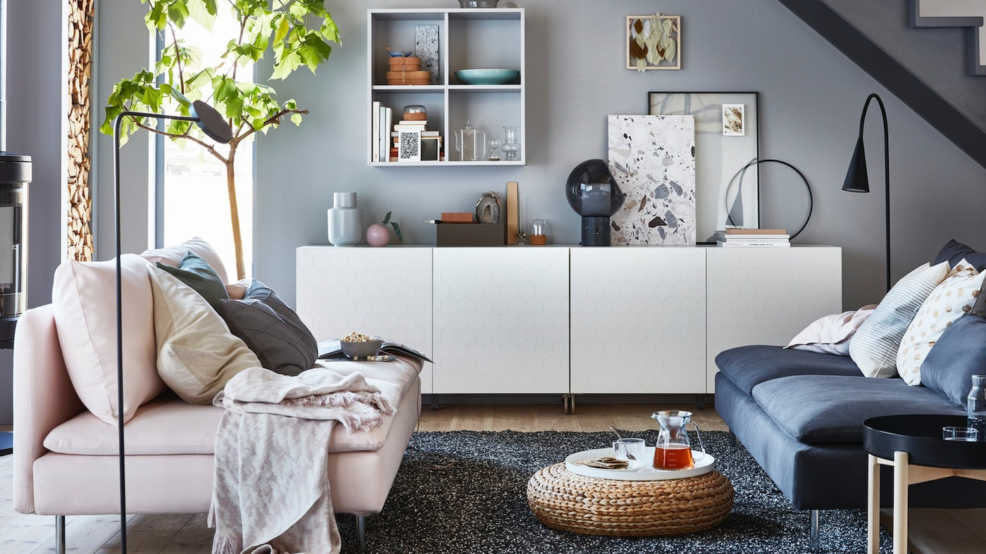 Living room with two sofas SÖDERHAMN in different colours, BESTÅ storage in white and EKET cabinets .