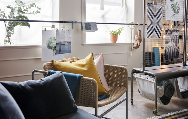 Living small but want to practise mindfulness at home? Create a room within a room with a smart room divider, such as IKEA VEBERÖD room divider in grey steel. It's got two linen pockets that are perfect for extra storage too.