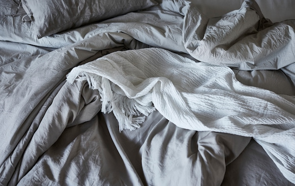 Load up your bedroom with lots of comfy bed linens to wrap yourself up in. IKEA FJÄDERKLINT compliment a nature-lover's style.