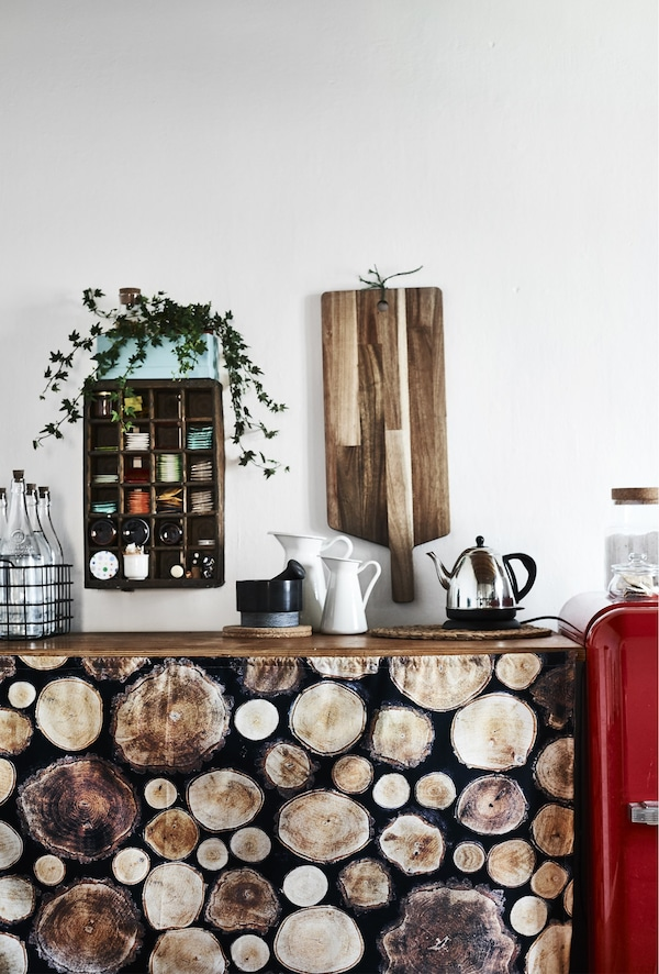 Log-print fabric draped in front of a kitchen counter.