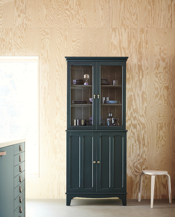 LOMMARP cabinet with glass doors in dark-blue green with crafted details for a traditional look.